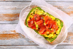 Salmon avocado scrambled egg ciabatta sandwich Royalty Free Stock Images