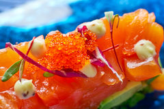 Salmon and avocado Tartare with soya Stock Images