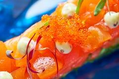Salmon and avocado Tartare with soya Royalty Free Stock Photo