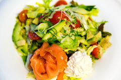 Salmon with avocado, tomatoes and cream Stock Photography