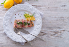 Salmon in the bacon coat Stock Images