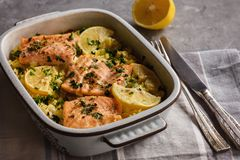 Salmon baked on oven with rice and lemon. stock images