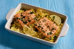 Salmon baked on oven with rice and lemon. stock photo
