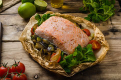 Salmon baked in papillote. Salmon baked with Mediterranean vegetables in papillote Royalty Free Stock Photography