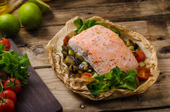 Salmon baked in papillote. Salmon baked with Mediterranean vegetables in papillote Stock Images