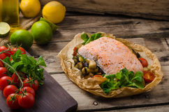 Salmon baked in papillote. Salmon baked with Mediterranean vegetables in papillote Royalty Free Stock Photos