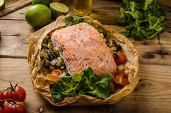 Salmon baked in papillote Stock Image