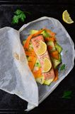 Salmon Baked In Parchment Paper. With Zucchini And Carrot Stock Images