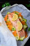 Salmon Baked In Parchment Paper. With Zucchini And Carrot Stock Image
