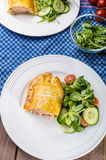 Salmon baked in puff pastry Stock Photos