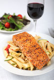 Salmon - Baked salmon with fresh pasta salad Stock Photo