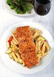 Salmon - Baked salmon with fresh pasta salad Stock Photography