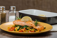 Salmon baked with thyme and Mediterranean vegetables Royalty Free Stock Images
