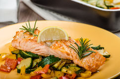 Salmon baked with thyme and Mediterranean vegetables Royalty Free Stock Image