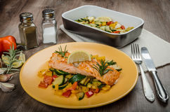 Salmon baked with thyme and Mediterranean vegetables Royalty Free Stock Photo