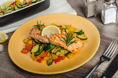 Salmon baked with thyme and Mediterranean vegetables Stock Image