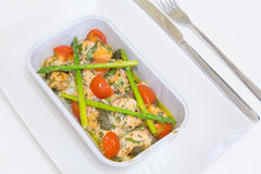 Salmon baked with tomato, capers and asparagus Stock Photo