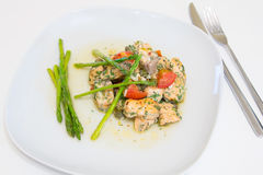 Salmon baked with tomato, capers and asparagus Stock Images