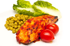 Salmon baked in tomatoe sauce isolated Royalty Free Stock Photo