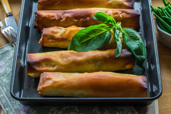 Salmon and basil butter filo parcels Stock Photography