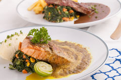 Salmon and beef steak Stock Photo