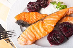 Salmon and beets with rosemary Royalty Free Stock Image