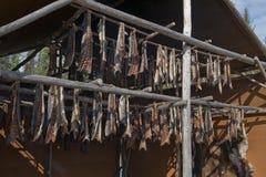 Salmon being smoked on rack Royalty Free Stock Photos