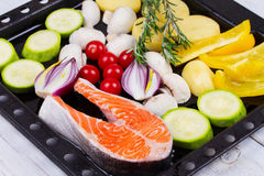 Salmon with Bell Pepper, Potato, Blue Onion, Mushrooms, Tomatoes,  and Rosemary. Stock Image