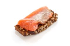 Salmon with black bread on white. Royalty Free Stock Photography