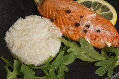 Salmon on black plate stock image