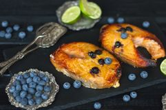Salmon with blueberries and honey, delicious seafood for lunch. royalty free stock image