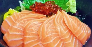 About salmon in a bow. Pieces of salmon and roe in a bow Stock Photo