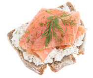 Salmon on a bread against white Stock Photography