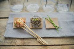 Salmon brochette with dill and pepper Stock Photos