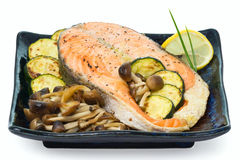 Salmon, broiled with mushrooms and zucchini. Stock Photos