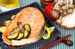 Salmon, broiled with mushrooms and zucchini. Royalty Free Stock Image