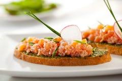 Salmon Bruschetta Стоковые Изображения