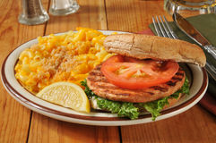 Salmon burger with Macaroni and Cheese Stock Photos