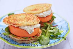 Salmon burger with potato pancakes Stock Photo