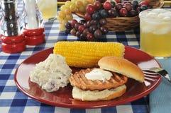 Salmon burger with potato salad stock images