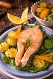 Salmon with butter fried potato puree and salad Royalty Free Stock Images