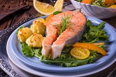 Salmon with butter fried potato puree and salad Royalty Free Stock Photos