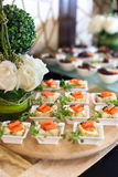 Salmon canapés. On buffet settings Royalty Free Stock Image