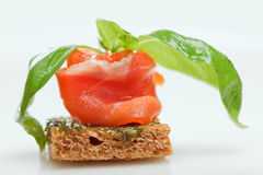 Salmon canape with basil. Isolated on white stock photo