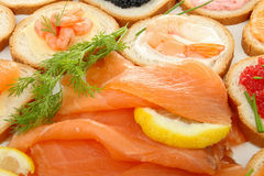 Salmon and canapes. Smoked salmon and canapes, buffet food Stock Images