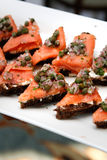 Salmon with capers on rye bread appetizer tray Royalty Free Stock Images