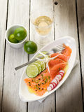 Salmon carpaccio. With slice grapefruit, lime and radish royalty free stock images