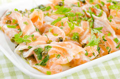 Salmon carpaccio - fresh salmon slices in marinade Royalty Free Stock Image