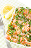Salmon carpaccio - fresh salmon slices in marinade Royalty Free Stock Photo