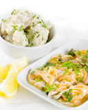 Salmon carpaccio (fresh salmon slices in marinade) with potato s Royalty Free Stock Images